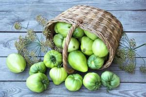 Wicker basket with vegetables photo