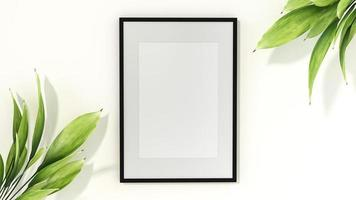 Picture frame mounted on the wall with flower vase photo