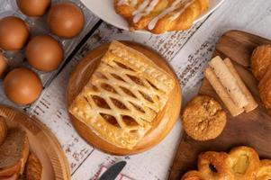 Various breads and eggs on red white cloth. Selective focus. photo