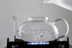 arreglo de té de agua caliente hirviendo foto