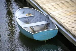 Wooden boats near a dock in the harbor photo