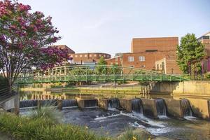 Green metal bridge going over a river, Greenville South Carolina photo