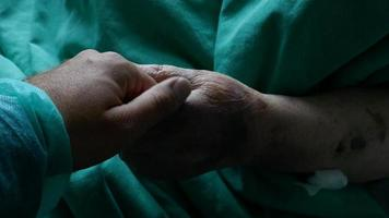 Footage of a person visiting grandmother in a hospital and stroking her hand... video