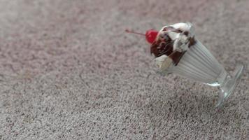 Ice cream sundae spilling on carpet in slow motion, shot on Phantom Flex 4K at 1000 fps video
