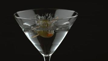 Slow motion shot of olive splashing into martini. shot on Phantom Flex 4K at 1000 fps video