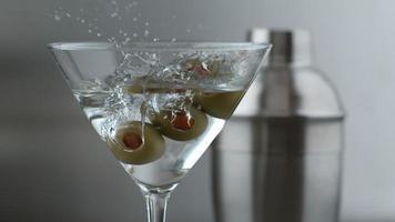 Slow motion shot of olives splashing into martini. shot on Phantom Flex 4K at 1000 fps video