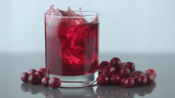 Ice splashing into cranberry juice in slow motion. shot on Phantom Flex 4K at 1000 fps video