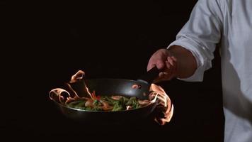 Slow motion shot of chef with flaming stir fry. shot on Phantom Flex 4K at 1000 fps video