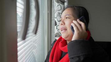 Woman Talking on Phone and Looking Out the Window video