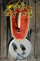 Watermelon And Other Fruits As Funny Face. Autumn Picnic In The Garden. Festive Harvest Background. photo