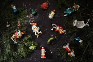 Beautiful Festive Figures As Glass Decorations For Christmas Tree On The Dark Wooden Table. photo