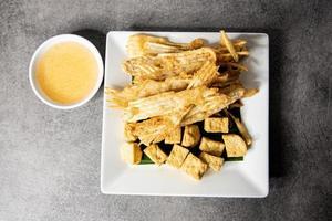 fried sliced taro and Deep Fried Tofu with spicy sweet sauce photo