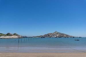 The sea under the blue sky, clean beaches and sea water, as well as islands and windmills photo