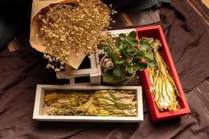 Dried pitaya flowers that can be used as food are on the wooden table photo