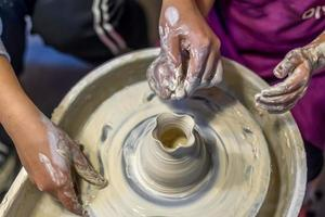 The process of making pottery in a Pottery Workshop photo