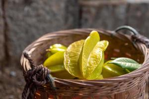 The Yellow carambola is ripe. Pick it and put it in the basket photo