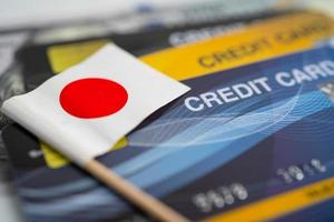 Japan flag on credit card. Finance development, Banking Account, Statistics, Investment Analytic research data economy, Stock exchange trading, Business company concept photo
