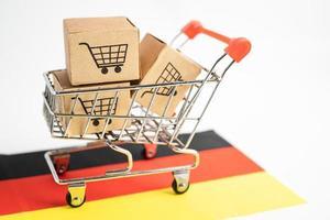 Caja con logotipo de carrito de compras y bandera de Alemania, importación, exportación, compras en línea o comercio electrónico, servicio de entrega de finanzas, tienda, envío de productos, comercio, concepto de proveedor foto