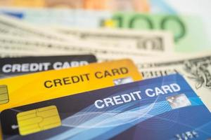 Credit card on Euro and US dollar banknotes. Finance development, Banking Account, Statistics, Investment Analytic research data economy, Stock exchange trading, Business company concept photo