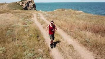 Aerial view. Man is running along general's beaches, Autumn in Crimea video