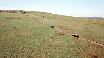 Aerial view. Cars go across the field. General's beaches, Crimea video