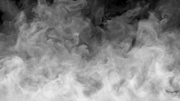Dynamic fog on a dark background. Realistic atmospheric video