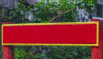 Empty blank red gold welcome sign to wat temple Laos. photo