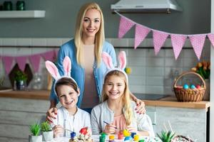 Portrait of mom with kids, easter kitchen decor. photo