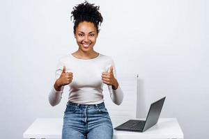 Attractive girl shows thumbs up, she is very happy photo