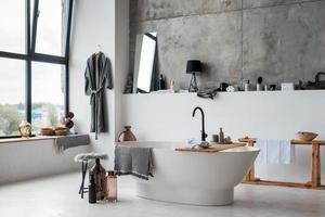 Stylish bathroom interior, stylish furniture, plumbing and accessories photo