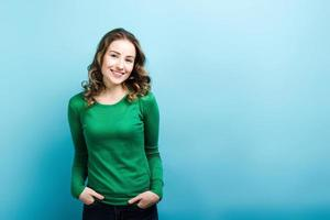 Smiling girl posing in green sweater. photo