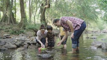 Slow-motion of an Asian family having fun together by the river video