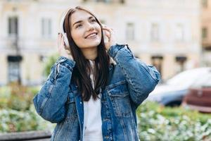 Girl relaxing and listening to music with her headphones photo