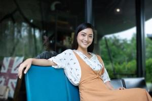 Asian women  smiling and happy Relaxing in a coffee shop after working in a successful office. photo