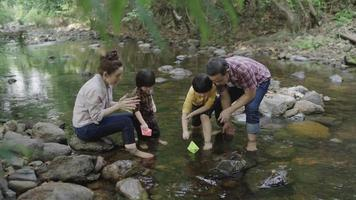 Slow-motion of Asian family having fun by the river video