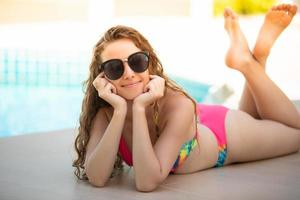 Women wear bikinis for swimming at the summer recreation pool photo