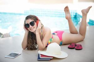 Women wear bikinis, she read books and listen to music at the summer recreation pool. photo