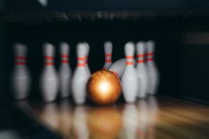 motion blur of bowling ball and skittles on the playing field photo