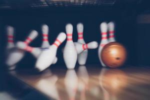 motion blur of bowling ball skittles on the playing field photo