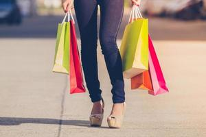 Asian women and Beautiful girl is holding shopping bags smiling while doing shopping photo