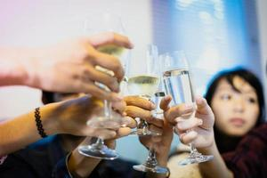 Asian group of friends having party with alcoholic beer drinks and Young people enjoying at a bar toasting cocktails.soft focus photo