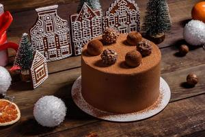 Delicious beautiful sweets on a dark wooden table on Christmas Eve photo