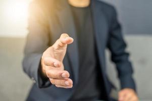 Businessman welcome to  shake hand business photo