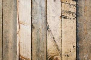 Old scratched and rustic wood wall panel photo