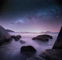 Rocky seascape starry sky photo