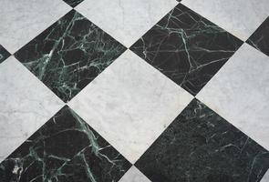 Chequered white green and black stone floor background photo