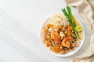 Pad Thai Seafood - Stir fried noodles with shrimps, squid or octopus and tofu photo