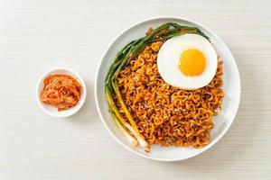 dried Korean spicy instant noodles with fried egg photo