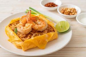 Thai stir fried noodles with shrimps and egg wrap - Pad Thai photo