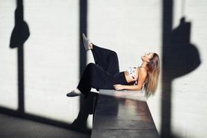 Young girl moving her legs in an urban background photo